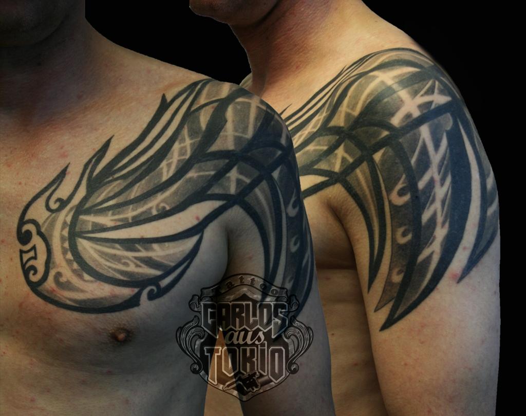 Hybrid tribal arm tattoo