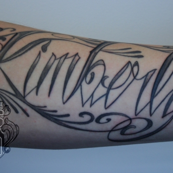 lettering arm tattoo