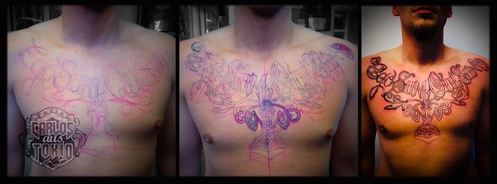 viking lettering chest tattoo