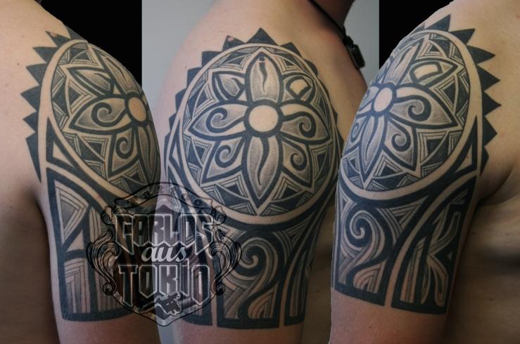 tribal sonne tattoo carlos aus tokio