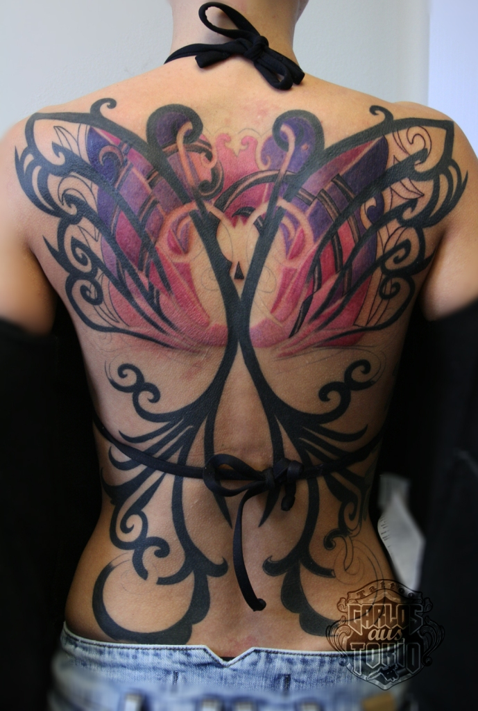 butterfly tribal back piece tattoo women
