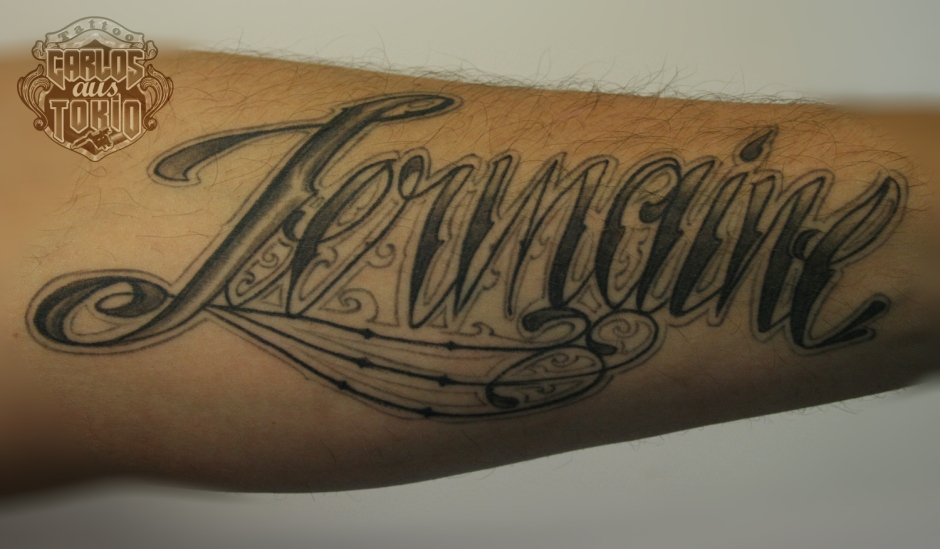 healed lettering tattoo