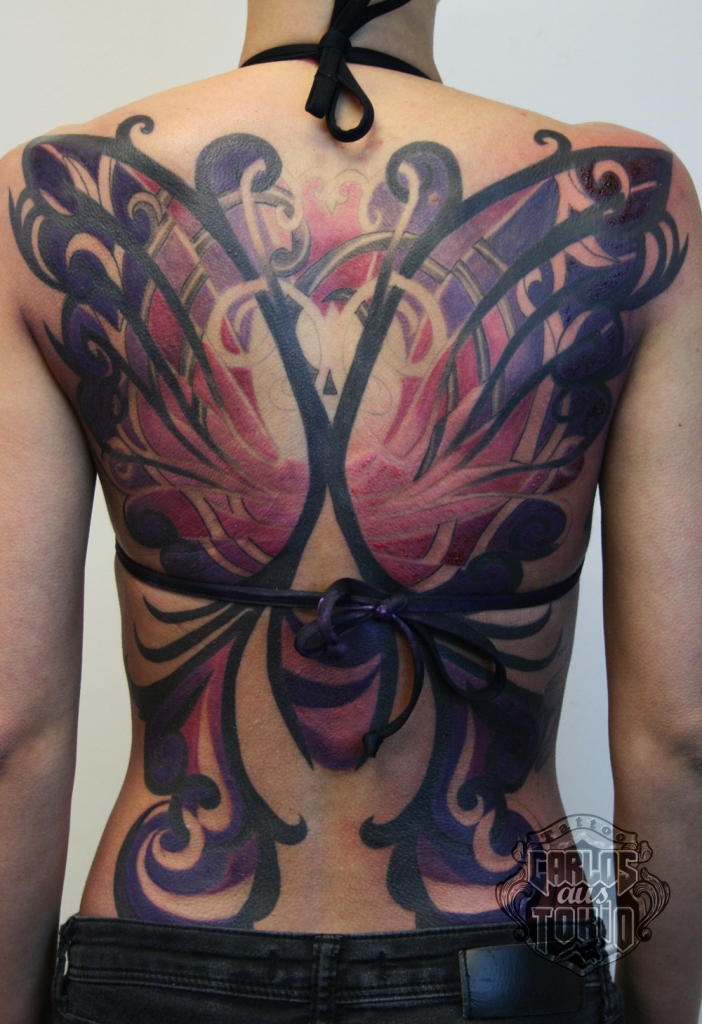 butterfly tribal back piece tattoo