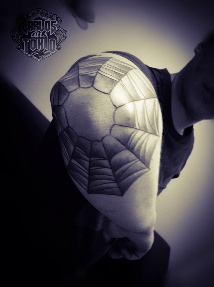 spiderweb tattoo elbow