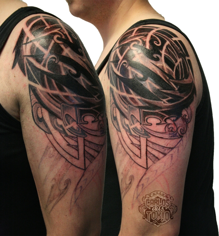 tribal biomechanical tattoo